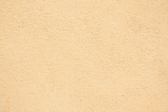 Stucco Wall. Orange Yellow stucco textured wall Royalty Free Stock Photo