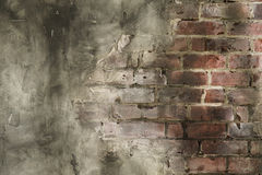 Stucco Wall with Bricks Exposed Background Stock Images