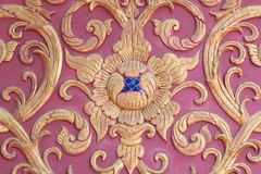 Stucco wall burgundy color thai art Royalty Free Stock Images