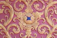 Stucco wall burgundy color thai art. Stucco gold red wall burgundy color thai art royalty free stock images