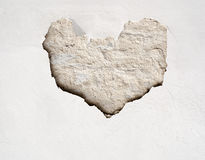 Stucco wall with heart shape. Stucco wall with cracked brick heart shaped Royalty Free Stock Image