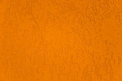 Stucco wall texture. Close up detail of an orange stucco wall texture Stock Photography