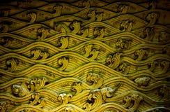 Stucco wall texture. Displays folk art of Thai people Royalty Free Stock Photo