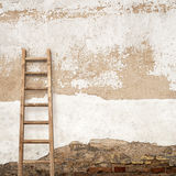Stucco wall with wooden ladder Royalty Free Stock Photography