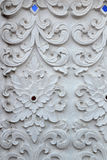 Stucco white sculpture decorative pattern wall design square format. Royalty Free Stock Images