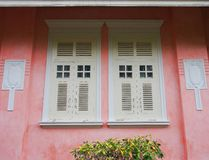 Stucco and window. Retro decorate on antique wall stock image