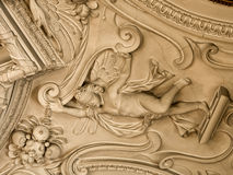 Stucco work inside Eggenberg Palace. Stucco cupid on the ceiling of room in Eggenberg Palace Stock Photography