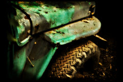 Stuck. A grungy military offroad vehicle stuck in the jungle Royalty Free Stock Photos
