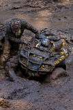 Stuck ATV Enduro. An ATV Enduro vehicle stuck in wet mud during a dirt track race Stock Images