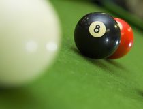 Stuck behind the 8-ball. 8-ball blocking shot on ball in game of pool royalty free stock image