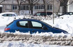 Stuck blue car Royalty Free Stock Image