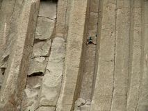 Stuck - climbing devils tower. A climber scaling devils tower in wyoming stock photos