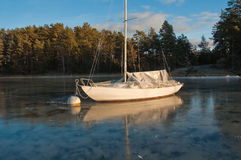 Stuck in the ice. A sailing boat stuck in the ice in the Stockholm archipelago, Sweden stock images
