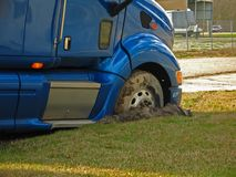 Stuck in the mud. Eighteen wheeler stuck in the mud Royalty Free Stock Images
