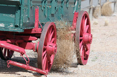 Stuck Tumbleweed. A view of a tumbleweed in desert blown into the wheels of a wagon due to winds Royalty Free Stock Photography