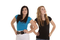 Stuck up teen girls. Two teen girl showing how rude and stuck up they are royalty free stock photography