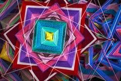 Stucken härlig mandala grunt djupfält Två stack den tibetana mandalaen från trådar, bästa sikt Fotografering för Bildbyråer