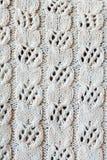 Stuckit från ullen med en openwork modellbakgrund royaltyfri bild