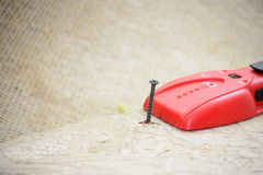 Stud Finder. Tool on bare sub floor to fix squeaky floor Royalty Free Stock Photography
