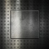 Studded metal background Stock Images