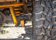 Studded SUV car tires with reinforced suspension stock photo