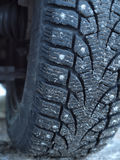 Studded tire on the winter road Stock Photos
