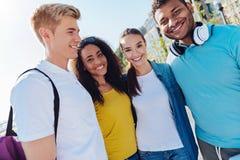 Horizontal picture of happy students that having break Stock Photo