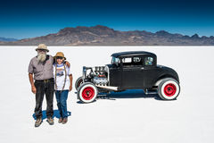 Hot Rod and owners. A couple proudly stand beside their Hot Rod at the Bonneville Salt Flats in 2013 Royalty Free Stock Image