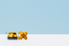 Studebaker at Bonneville. A yellow Studebaker with parachute open after completing a land speed record attempt at the Bonneville Salt Flats in 2013 Royalty Free Stock Images