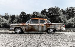 57 Studebaker Rusted. Circa 1957 old rusted vintage Studebaker 2 door car on the side of a road in Carmel, Maine. Taken July 2017 Royalty Free Stock Photo