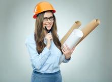 Studencki dziewczyna architekt jest ubranym szkła trzyma staczającymi się w górę technic fotografia stock