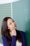 Studencki główkowanie o maths formule Zdjęcia Royalty Free