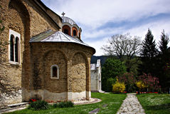 Studenica Monastery. The most famous Serbian monastery with beautifull park and flowers at sunny summer day with clear blue sky Stock Photos