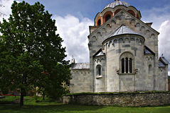 Studenica Monastery. The most famous Serbian monastery with beautifull park and flowers at sunny summer day with clear blue sky Stock Photo