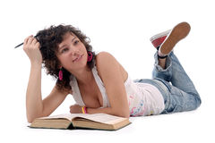 Student. Young female lying on the floor with boook isolated Stock Photos