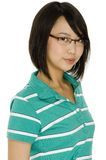Student. An attractive young asian student in glasses and a green polo shirt on white background stock images