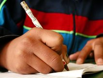 Student. A third-world country student writing homework Stock Photo