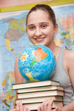 Student. A student girl with books and globe stock image