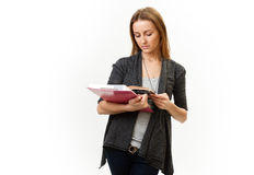 Student. Young pensive girl, concentrated reading. Isolated gray background Stock Photography