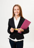 Student. Young cheerful girl, standing with a tablet and pen in hand. Isolated gray background Royalty Free Stock Image