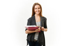 Student. Young gay girl stands with books in their hands. Isolated white background Royalty Free Stock Image