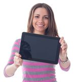 Student. Happy brunette woman holding in hand a tablet touch pad computer and smiling on a white background Stock Photos