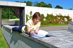 Student. Girl resting near the university with her notes Royalty Free Stock Photos