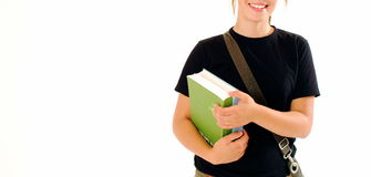Student. A closeup of a female student, cropped at her mouth and torso. She is smiling and holding some books stock photo