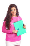 Student. Pretty student holding notes and pen Royalty Free Stock Photography
