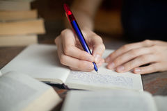 Student. Woman hands writing in notepad, picture about learning or education Royalty Free Stock Image