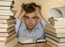 Student. Is learning his homework with textbooks Stock Photography
