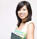 Student. Young Asian woman with books Royalty Free Stock Image