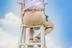 Student acting like a superhero on top of stepladder i royalty free stock image