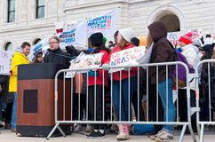 Student Activist Addresses Crowd at Rally. Saint Paul, Minnesota, USA – MARCH 24, 2018: Student addresses crowd from podium at State Capitol during March for Royalty Free Stock Photos